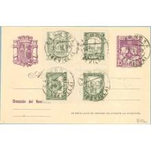 1939. R. Católicos.15 c. violeta + Sellos Benéficos. Cinco matasellos Carmona Sevilla (Laiz 81FLa) 60€